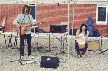 Two thirds of the The Young Band playing at a car show in June