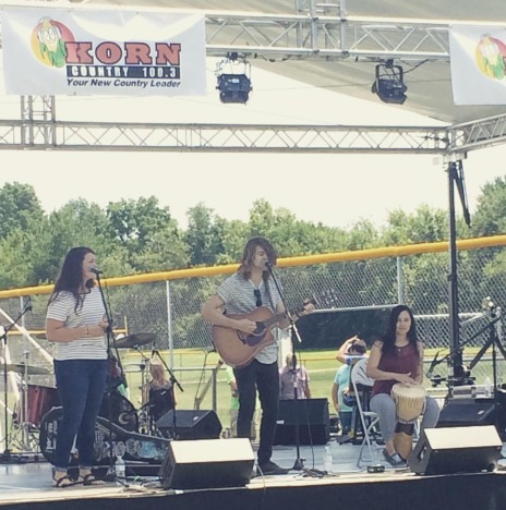 On the stage at the Greenwood Freedom Fest